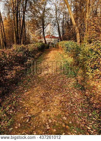 Odintsovo, Russia - October 14, 2020. Path Through Autumn Park To Main Building Of Zakharovo Manor.