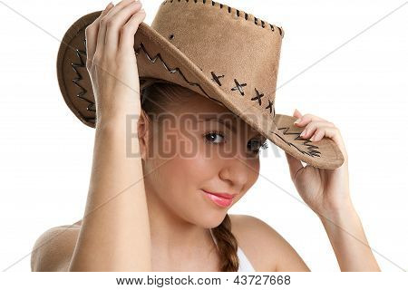Beautiful Smiling Cowgirl over white background wearing hat
