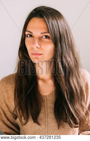 Millennial Young Pretty Woman At Home Sitting On The Couch. Confident And Healthy Portrait. Long Bro