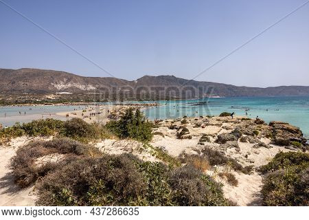 Elafonisi, Crete, Greece - Sept 19, 2021: People Relaxing On The Famous Pink Coral Beach Of Elafonis