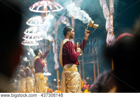 17.12.2019, Varanasi, India. Sacred Religious Ceremony Arati In The Temple. A Group Of People Burn I