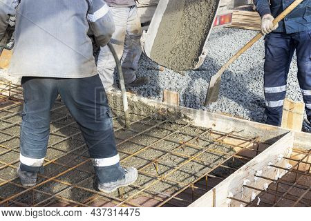Pouring Cement Or Concrete With A Concrete Mixer Truck, Construction Site With A Reinforced Grillage