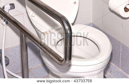 Toilet Room.
