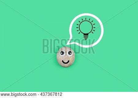 Character From A Pebble With A Happy Face And A Burning Light Bulb In His Mind. Сharacter From The P