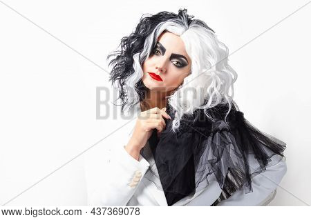 A Charismatic Unusual Woman In A Black And White Outfit With Black And White Hair, A Bold And Stylis