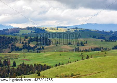 The Perspective And Rhythm Of The Mountain Hills Of The Spring Carpathians With Low Clouds, But Illu