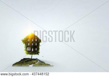 Green grass eco house . Mixed media