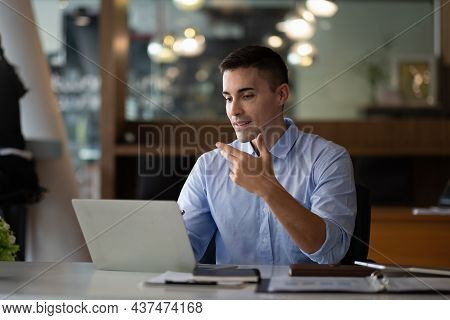 Smiling Businessman Having Virtual Team Meeting Call, Talking, Remotely Working At Home Watching Onl
