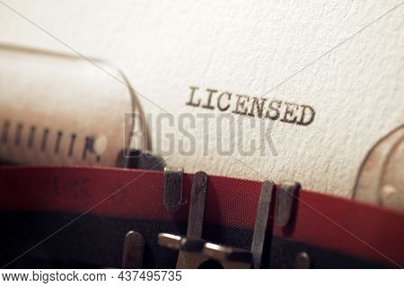 The word licensed written with a typewriter.