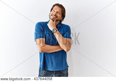 Handsome middle age man standing together over isolated background with hand on chin thinking about question, pensive expression. smiling and thoughtful face. doubt concept.