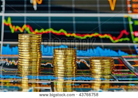 Downtrend Financial  Chart And Stacks Of Golden Coins