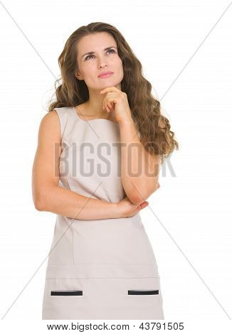 Portrait Of Thoughtful Young Woman Looking On Copy Space