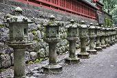 Nikko Japan - UNESCO World Heritage Site. Part of Tosho-gu Shinto shrine traditional stone lanterns. poster