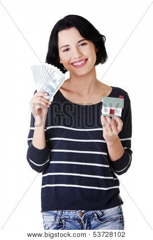 Attractive girl with money and house on hands.  isolated on white.