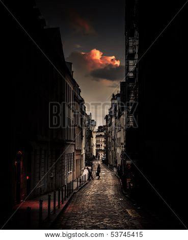 Red cloud over a parisian street