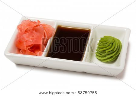 Pickled ginger with soy sauce and wasabi for sushi. Isolated on white.
