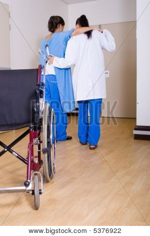 Doctor Helping Patient