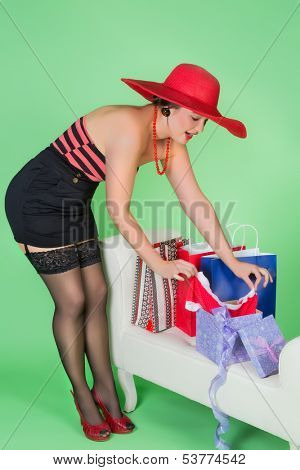 Elegant pin up girl unwrapping a sexy present