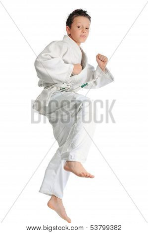 Young boy making karate exercise over white