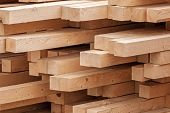 New wooden boards on a storage. Abstract background poster