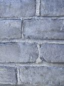 Closeup of a silver painted brick wall background poster