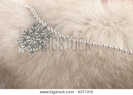 Christmas Decorations Resting On White Fur