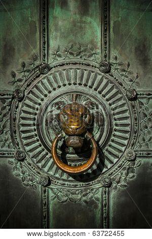 Brass Lion Doorknocker On A Bronze Door