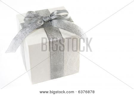 Gift Box With Silver Bow And Ribbon Isolated