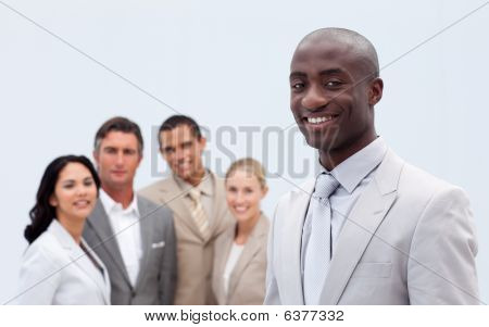 Smiling Afro-american Businessman In Front Of His Team
