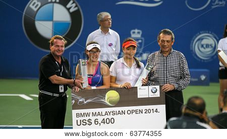 KUALA LUMPUR - APRIL 20, 2014:Chan Yung-Jan (white) of Taiwan and Zheng Saisai of China (blue-red) emerge runners-up in the Doubles of the BMW Malaysian Open Tennis in Kuala Lumpur, Malaysia.