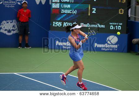 KUALA LUMPUR - APRIL 20, 2014: Zheng Saisai of China returns at the doubles final of the BMW Malaysian Open Tennis in Kuala Lumpur, Malaysia. She partners Chan Yung-Jan of Taiwan to emerge runners-up.