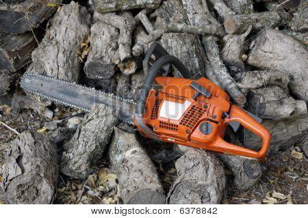 Chain Saw And Wood