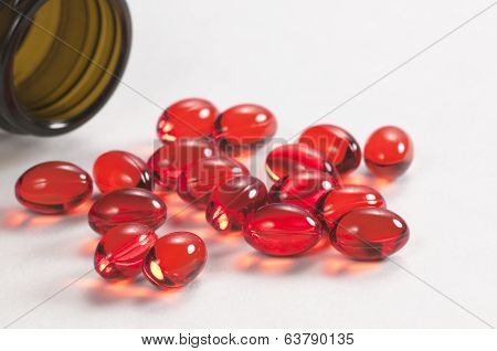 Red Capsules Near The Box