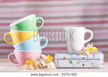 Colored Cups With A Pitcher And Daffodils Vintage Retro