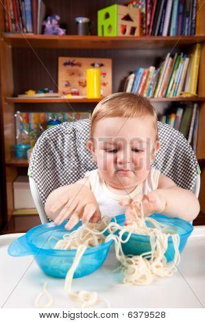 Little Boy Investigating Pasta