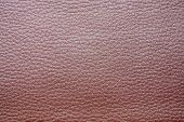glossy texture of skin and imitation leather of pink color for an abstract background and for wallpaper poster