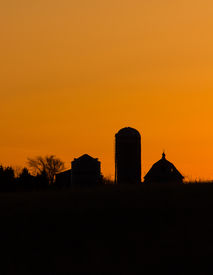 Farm Silhouette at Sunset