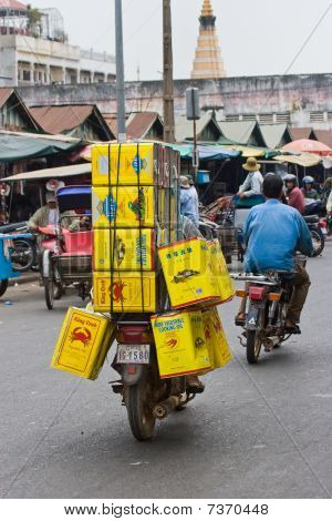 Overloaded motorcycle in Phnom Penh, Cambodia