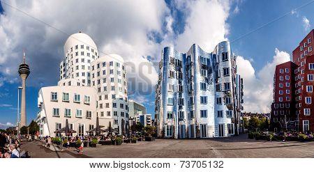 Panoramic view of three futuristic building Neue Zollhof located in Media Harbor