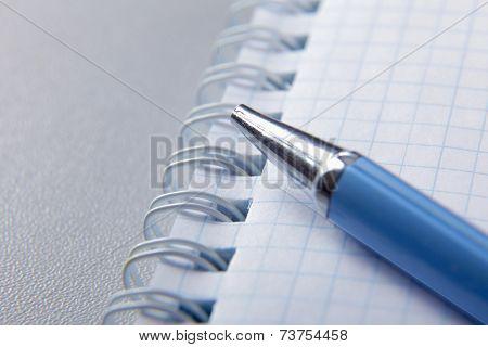 pen lying on a notebook