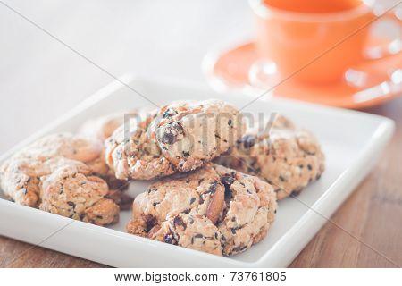 Closeup Mixed Nut Cookies With Mini Orange Coffee Cup