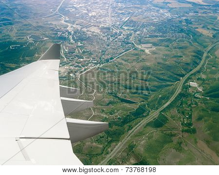After takeoff from Barajas Airport Madrid Spain. Aerial view from aircraft window. poster