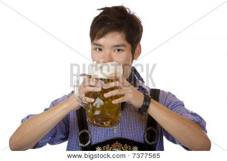 Young Handsome Man Drinking Out Of Oktoberfest Beer Stein (mass)
