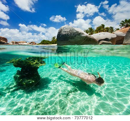 Split photo of young woman snorkeling in turquoise ocean water among corals and tropical fish on Virgin Gorda, British Virgin Islands, Caribbean poster