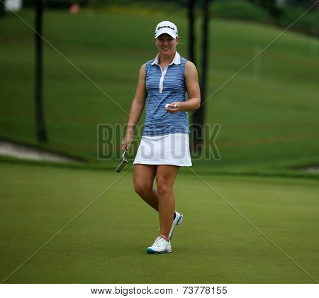 KUALA LUMPUR, MALAYSIA - OCTOBER 11, 2014: Austin Ernst of the USA reacts after her put at the third hole of the KL Golf & Country Club during the 2014 Sime Darby LPGA Malaysia got tournament.