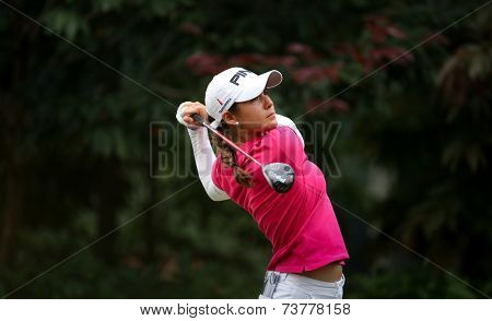 KUALA LUMPUR, MALAYSIA - OCTOBER 11, 2014: Azahara Munoz of Spain tees off at the fourth hole of the KL Golf & Country Club during the 2014 Sime Darby LPGA Malaysia golf tournament.