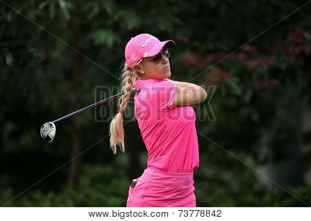 KUALA LUMPUR, MALAYSIA - OCTOBER 11, 2014: Natalie Gulbis of the USA tees off at the fourth hole of the KL Golf & Country Club during the 2014 Sime Darby LPGA Malaysia golf tournament.