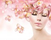 Fashion Beauty Model Girl with Orchid Flowers Hair. Spa woman. Bride. Perfect Creative Make up and Hair Style. Hairstyle. Nude makeup. Bouquet of Beautiful Flowers on lady's head poster