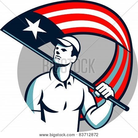 Illustration of an American tradesman handymanpatriot holding a USA stars and stripes flag on shoulder set inside circle on isolated white background. poster