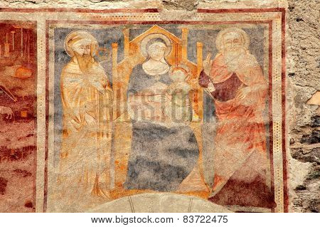 Religion medieval fresco on the church wall in Bormio, Italy poster
